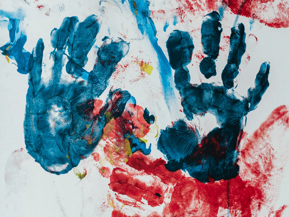 Handprints made of different colors on a white background.